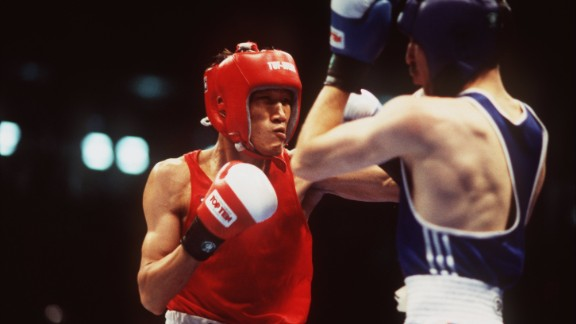 Todorov (right) turned them down -- a decision he regrets to this day -- being confident he would win gold and have a successful amateur career. He beat the 19-year-old Mayweather by one point in a controversial featherweight semifinal, leaving just Thailand's Somluck Kamsing (left) as an obstacle to Olympic glory.