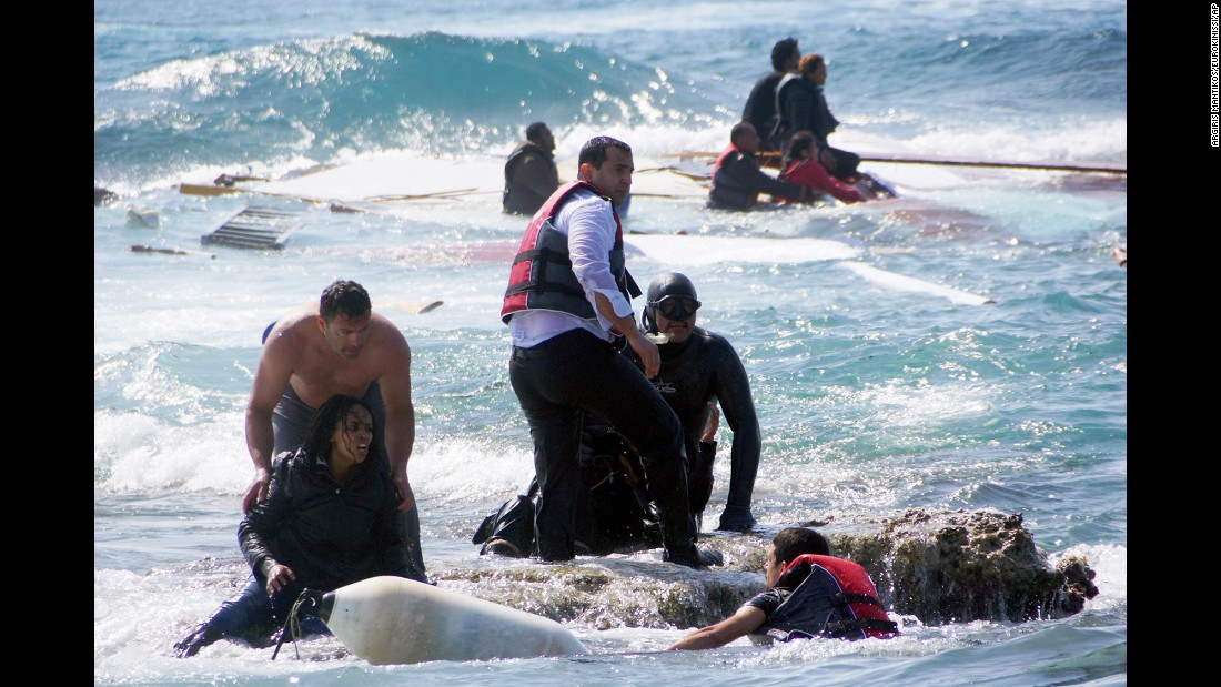 "Migrants are rescued from the Aegean Sea, off the coast of the Greek island of Rhodes, on Monday, April 20. Greek authorities said that at least three people died after their wooden boat ran aground. There has been <a href=""http://www.cnn.com/2015/04/21/world/gallery/europe-migrant-crisis/index.html"" target=""_blank"">a recent surge</a> in the number of migrants making the dangerous journey toward Europe's shores."