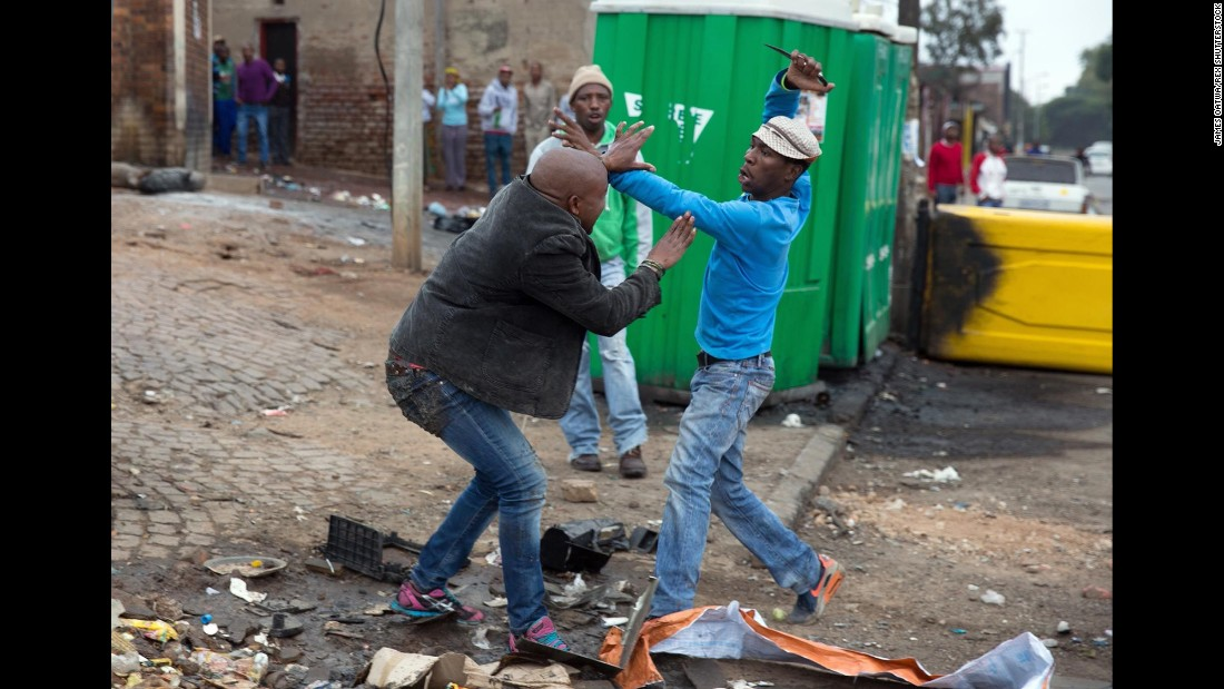 "Mozambican Emmanuel Sithole, left, was walking down a street in Johannesburg's Alexandra Township when four men surrounded him on Saturday, April 18. Sithole pleaded for mercy, but it was already too late. The attackers bludgeoned him with a wrench and stabbed him with knives, killing him in broad daylight. <a href=""http://www.cnn.com/2015/04/20/world/gallery/south-africa-attack/index.html"" target=""_blank"">Photographer James Oatway was nearby</a> and captured it all on his camera."