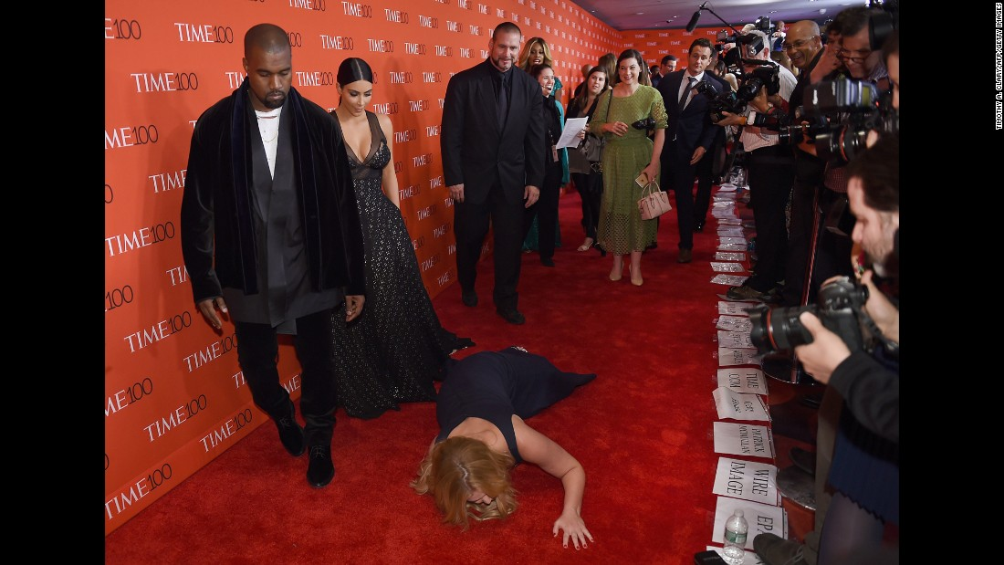 "Comedian Amy Schumer pretends to trip and fall on the floor in front of celebrity couple Kim Kardashian and Kanye West as they attend the Time 100 Gala in New York on Tuesday, April 21. Schumer, Kardashian and West were all on Time magazine's list of <a href=""http://time.com/collection/2015-time-100/"" target=""_blank"">The 100 Most Influential People</a>."