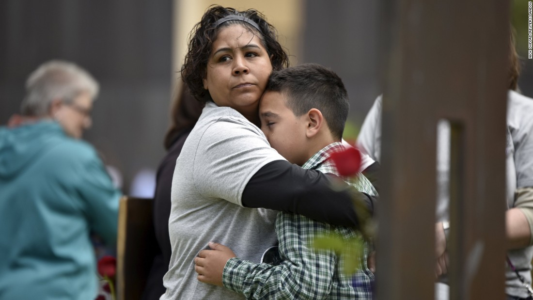 "Kathy Dutton comforts her 10-year-old son, Kolby, near the memorial chair of her nephew Zachary Chavez during a ceremony Sunday, April 19, for victims of the Oklahoma City bombing. On April 19, 1995, the Albert P. Murrah Federal Building in Oklahoma City was rocked by a truck bomb. <a href=""http://www.cnn.com/2013/07/26/us/gallery/crimes-of-the-century-okc-bombing/index.html"" target=""_blank"">The terrorist attack</a> killed 168 people and injured more than 500."