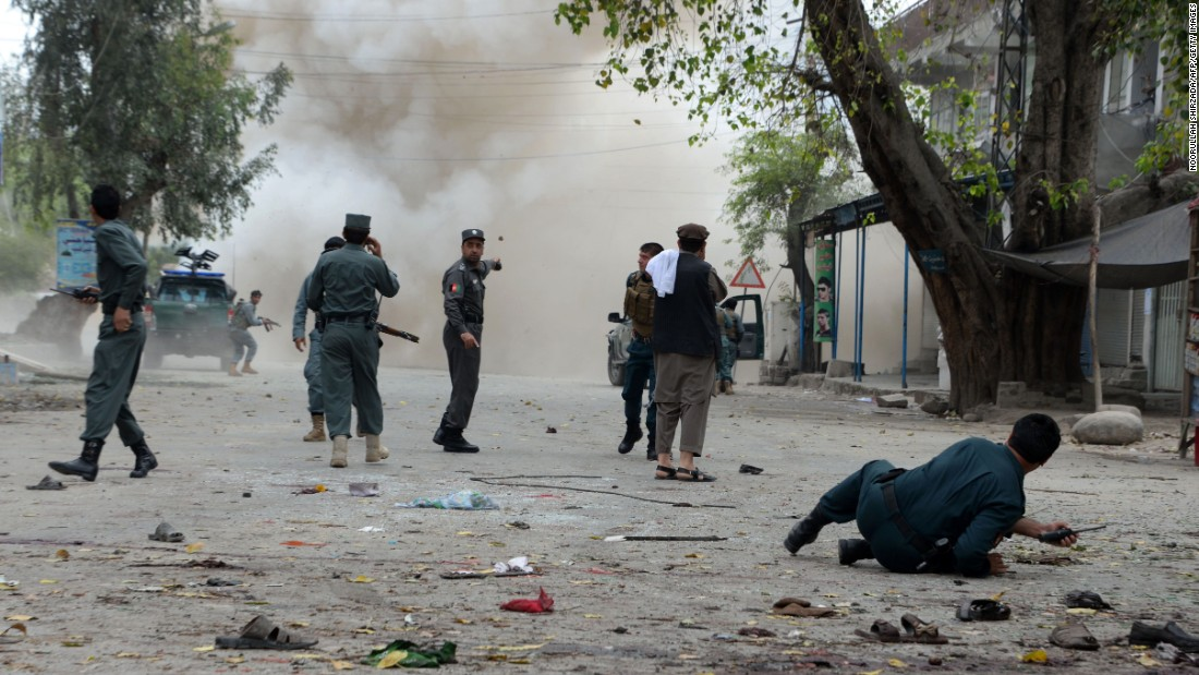"Security personnel in Jalalabad, Afghanistan, gather at the scene of an explosion on Saturday, April 18. A suicide bomber on a motorbike <a href=""http://www.cnn.com/2015/04/18/asia/afghanistan-violence/index.html"" target=""_blank"">blew himself up in front of a bank,</a> a local government spokesman said. The ISIS terrorist group claimed responsibility for the attack, which killed at least 33 people and injured more than 100 others, public health spokesman Najibullah Kamawal said. The claim appears to be the first in Afghanistan by ISIS, CNN's Nick Paton Walsh said."