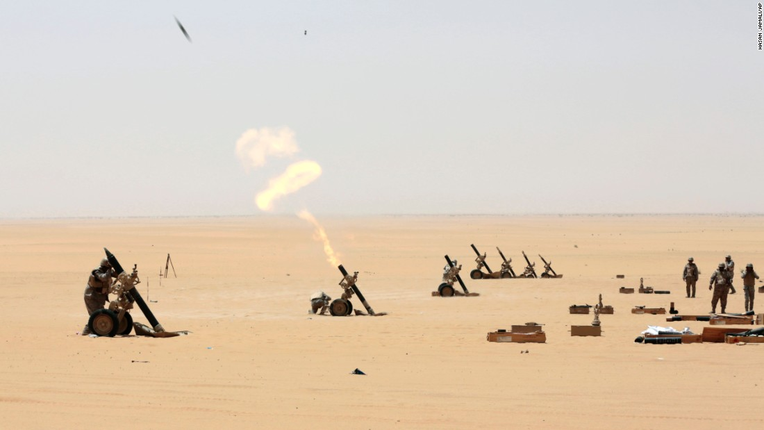 "Saudi soldiers in Najran, Saudi Arabia, fire artillery toward the Yemeni border on Tuesday, April 21. A Saudi-led coalition <a href=""http://www.cnn.com/2015/01/20/world/gallery/yemen-unrest/index.html"" target=""_blank"">has been carrying out strikes against Houthi rebels in Yemen</a> since Yemeni President Abdu Rabu Mansour Hadi fled the country in late March. The Houthis are Shiite Muslims who have long felt marginalized in Yemen, a majority Sunni country. The Sunni Saudis consider the Houthis proxies for the Shiite government of Iran and fear another Shiite-dominated state in the region."