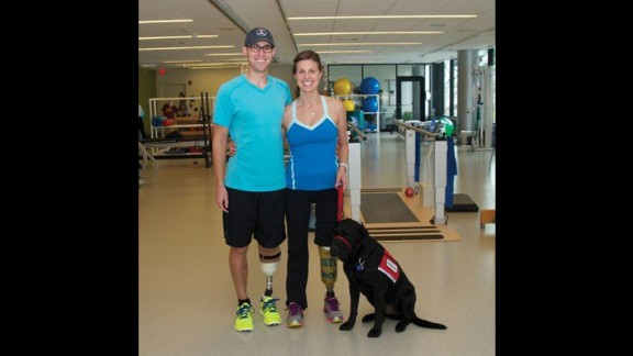"""Patrick Downes and Jessica Kensky Downes met when they were interns on Capitol Hill. She lost both legs and was pushed into court in a wheelchair. Her aide dog, Rescue, lay beside her as she testified. """"I remember being happy, I remember feeling sunlight on my face. I remember feeling free."""" And then the bomb went off. Because she is a nurse, she focused on saving her husband. His foot and part of his leg were hanging by a thread. She remembers screaming, and not being able to hear anything. This photo was taken before she decided to amputate her second leg in January. """"I wanted to paint my toenails and put my feet in the sand. I wanted all of those things, and to lose my second leg was a gut-wrenching decision."""""""