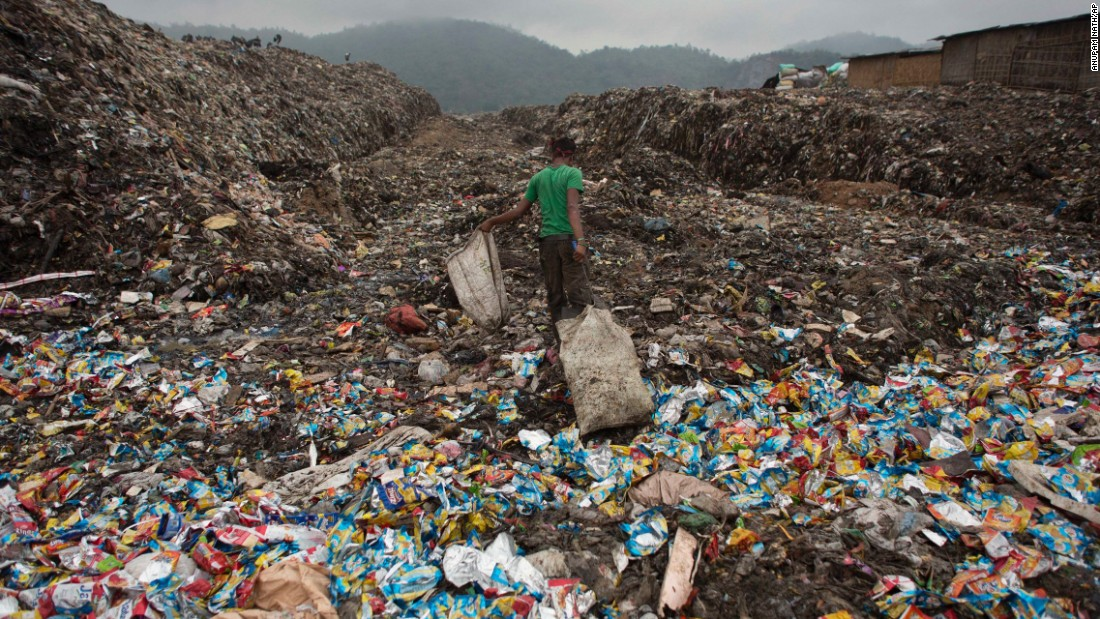 "A boy pulls a bag filled with recyclable material at a garbage dump in Gauhati, India, on Wednesday, April 22. <a href=""http://www.cnn.com/2015/04/14/world/cnnphotos-boragaon-landfill-india/index.html"" target=""_blank"">Related: Living inside a landfill</a>"