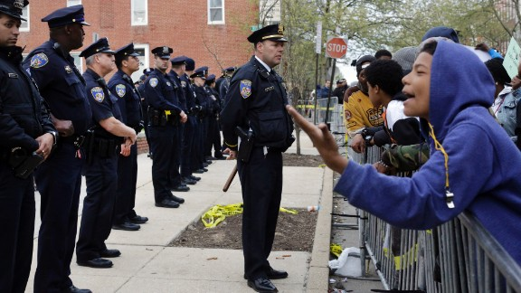 Members of the Baltimore Police Department stand guard Thursday, April 23, outside the department