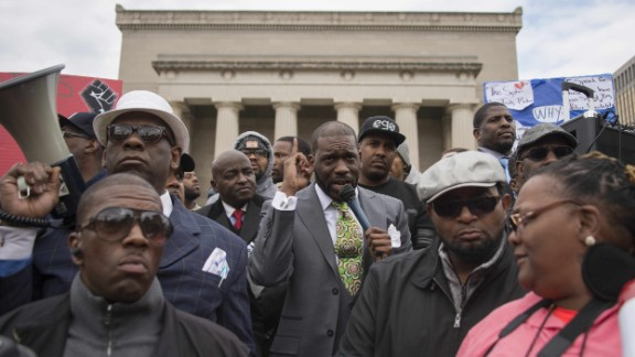 Empowerment Temple Pastor Jamal Harrison Bryant speaks in front of City Hall in Baltimore on April 23.