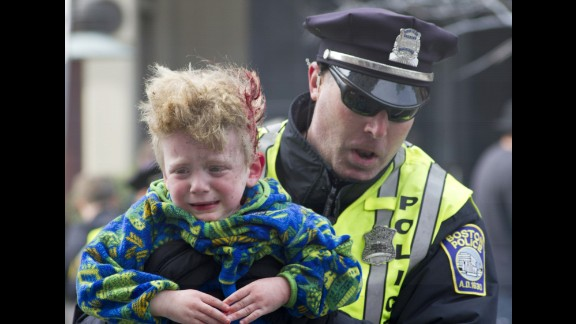 Leo Woolfenden was lifted from his stroller by a first responder as the boy