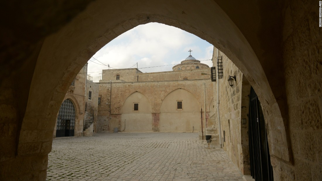 The St. James Cathedral is seen through arches in the Armenian Quarter.