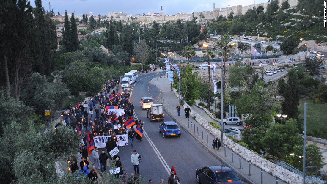 Armenian community members walk through the streets during a candlelit vigil in Jerusalem on April 23.