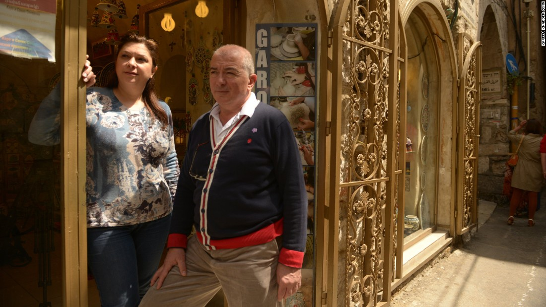 Armenian ceramists Garo and Sonia Sandrouni stand in front of their shop in the old city of Jerusalem.