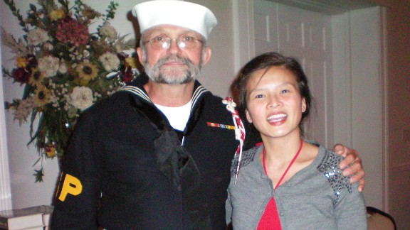 """Kent """"Chippy"""" Chipman reunites with Mina Nguyen, who was just 10 months old when he helped save her life."""