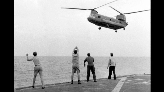 The crew of the USS Kirk frantically wave away Ba Van Nguyen as he approaches the ship with his family.