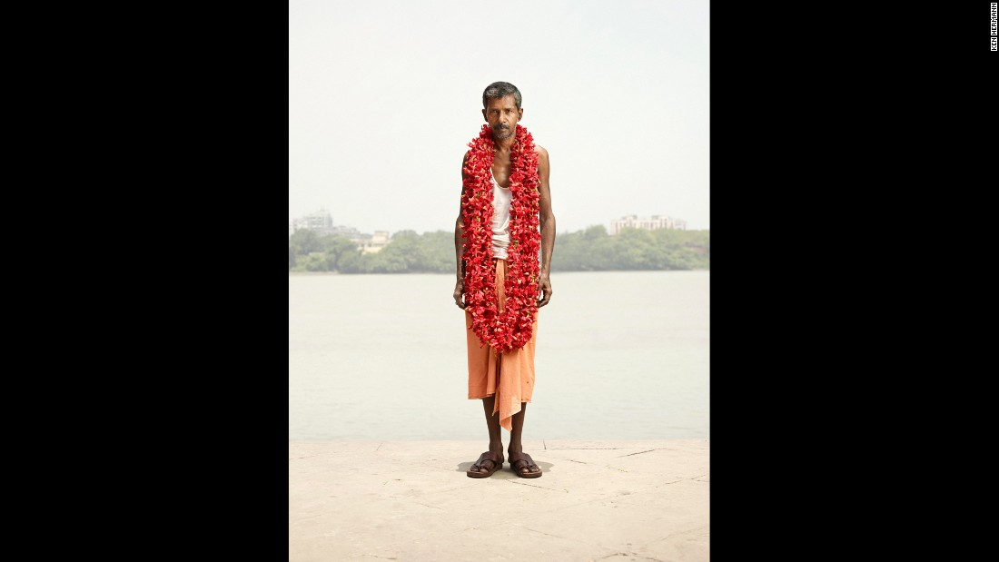 Hermann's photos have a surreal effect and overexposed look that make his subjects stand out. In this portrait, S.K. Bhagat pops with color as he wears a necklace of java flowers for sale around his neck.