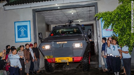 A police armored vehicle believed to be carrying Mary Jane Veloso leaves Wirogunan prison in Yogyakarta.