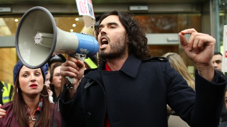 Russell Brand, seen here campaigning against social housing evictions in London last year, has rejected voting altogether.