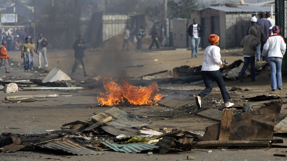 Immigrants, mainly from Zimbabwe, are attacked amid social problems, such as unemployment, crime and a lack of housing.
