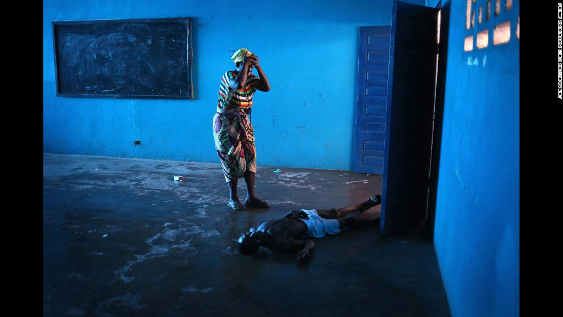 Getty Images special correspondent <strong>John Moore</strong> has taken the top prize in Sony World Photography Awards 2015 for his early exposure of the Ebola epidemic in Liberia's capital Monrovia.