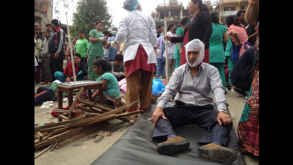 Injured people receive treatment in Kathmandu. A CNN reporter said medics were focused on treating the most severely injured.