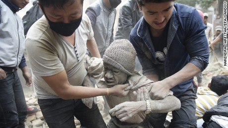 People free a man from the rubble of a destroyed building in Kathmandu.