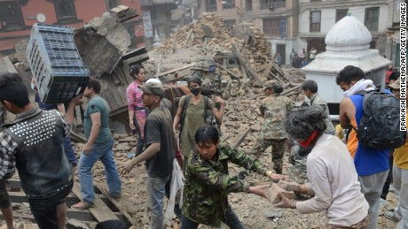 People clear rubble in Kathmandu's Durbar Square on Saturday, April 25.