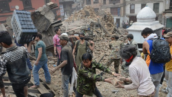 People clear rubble in Kathmandu
