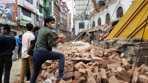 "A massive earthquake centered less than 50 miles from Kathmandu rocked Nepal with devastating force early Saturday. Hundreds have been killed. Americans Rob and Kari Stiles in Kathmandu described the scene as a ""war zone."""