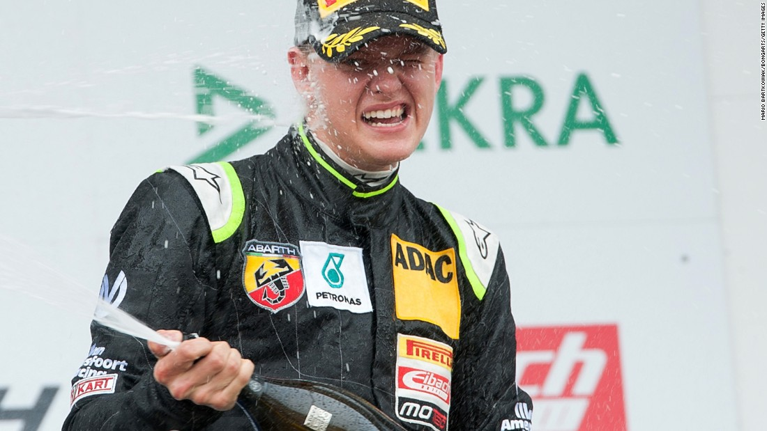 Mick Schumacher celebrates after winning the trophy for the best rookie in the opening race of the new ADAC Formula Four championship.