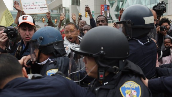 Protesters get into a shoving match with police during a march downtown on April 25.