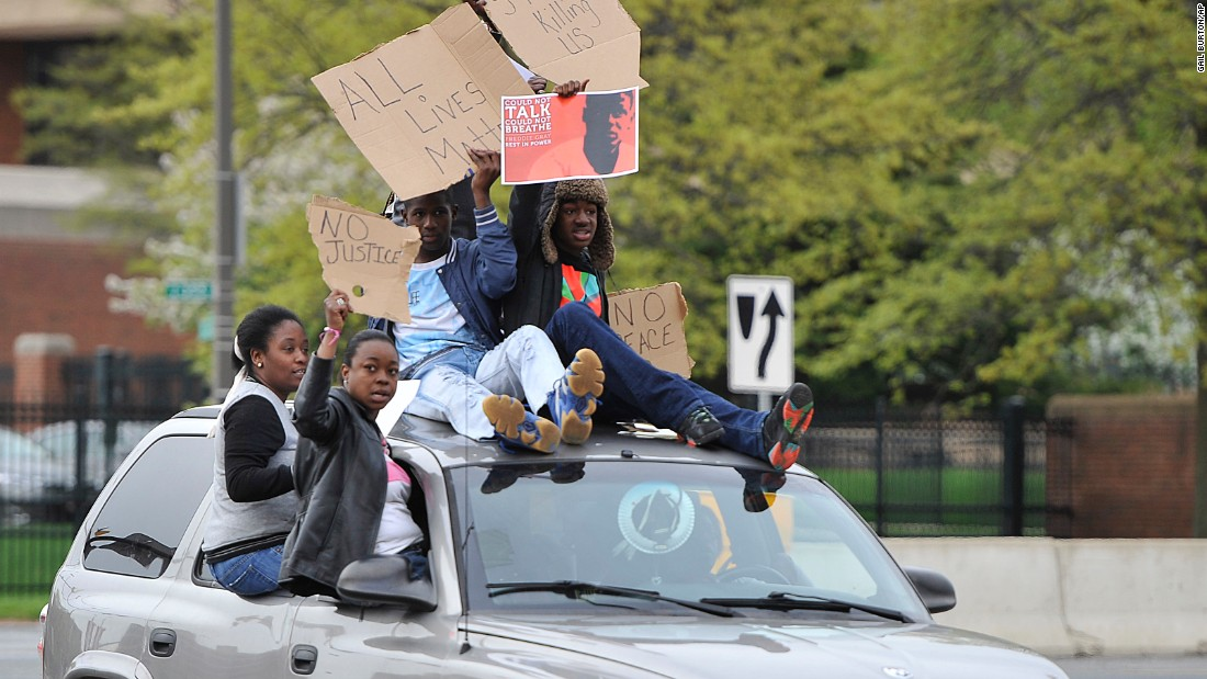 Protesters drive through the Camden Yards area on April 25.