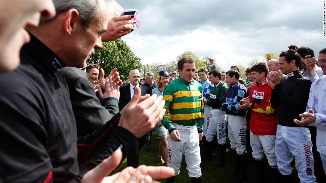 "McCoy, who won 4,382 races <a href=""/2015/02/10/horseracing/ap-mccoy-horse-racing-retirement/index.html"" target=""_blank"">and broke just about every bone in his body</a>, was cheered into the parade ring by his fellow jockeys."