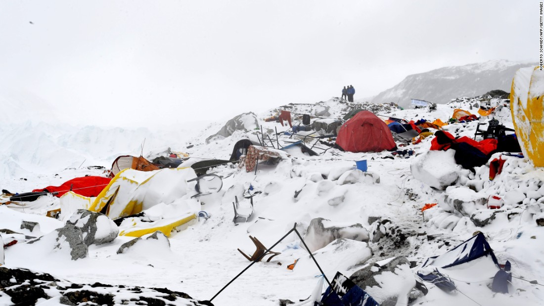 People look at the devastation on April 25 after the avalanche.