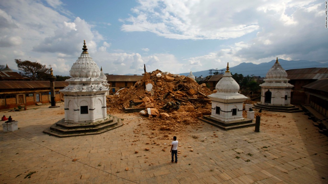 People look at the debris of one of the oldest temples in Kathmandu on April 26.