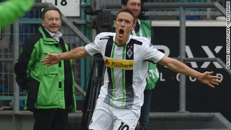 Max Kruse celebrates his late winner for Borussia Moenchengladbach which ensured Bayern Munich clinched the German title.