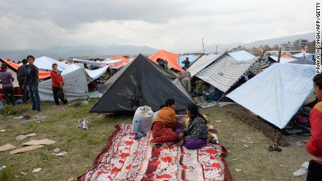 Nepalese people stay outside in tents on the outskirts of Kathmandu.