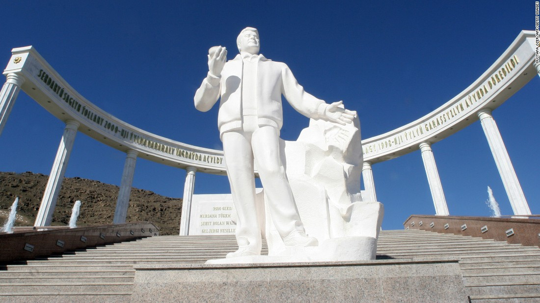 A statue of Turkmenistan's former President Saparmurad Niyazov sits in front of the earthquake memorial in Ashgabat, 13 February 2007. Almost all the brick buildings in Ashgabat, collapsed and 110,000 people were killed when a magnitude-7.3 earthquake struck October 5, 1948.