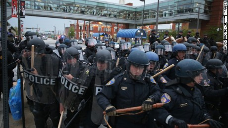 Police in riot gear block a street during a march in honor of Freddie Gray in Baltimore on April 25.