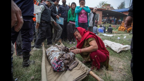 A woman cries after identifying the body of a relative in Bhaktapur on April 26.