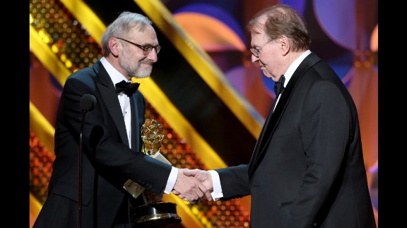 "Rand Morrison, left, and Charles Osgood accept the outstanding morning program award for ""CBS Sunday Morning."""