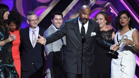 Steve Harvey and the crew of his show accept the award for outstanding informative talk show.