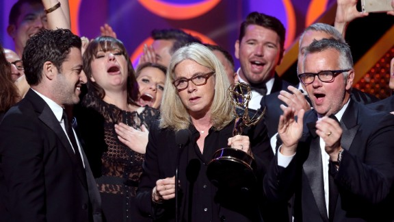 """From left, executive producers Andy Lassner, Mary Connelly and Ed Glavin accept the outstanding entertainment talk show award with the crew of """"The Ellen DeGeneres Show."""""""