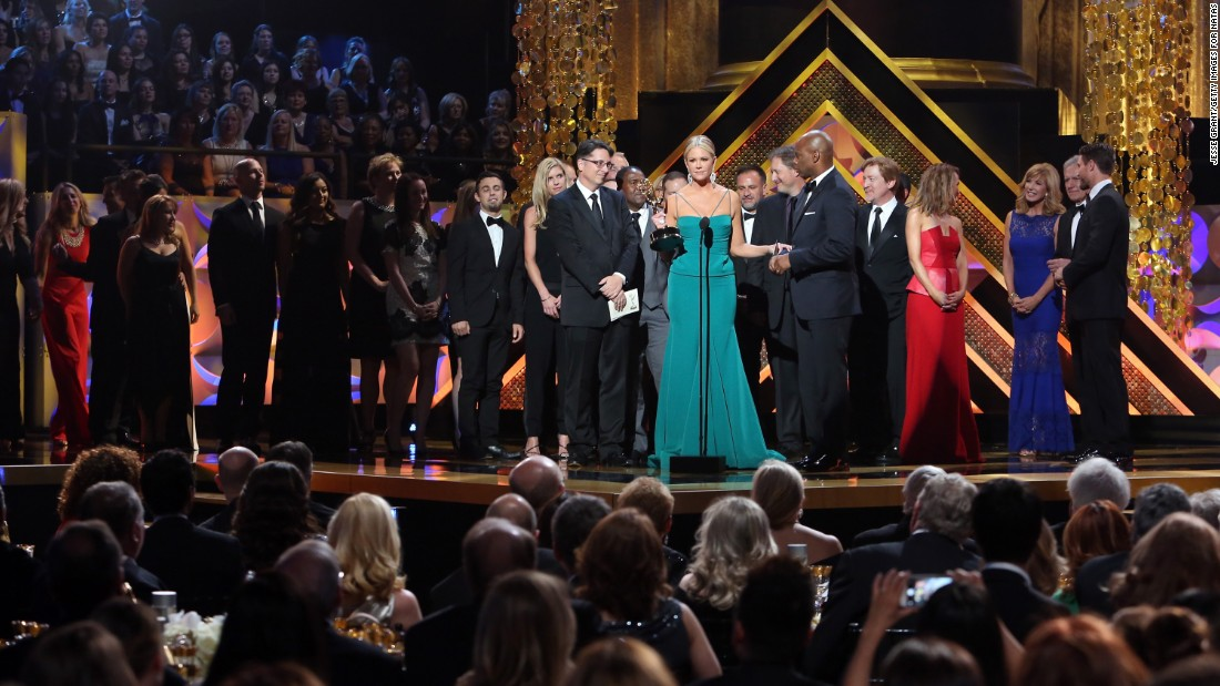 "Nancy O'Dell and the cast and crew of ""Entertainment Tonight"" accept the award for outstanding entertainment news program."