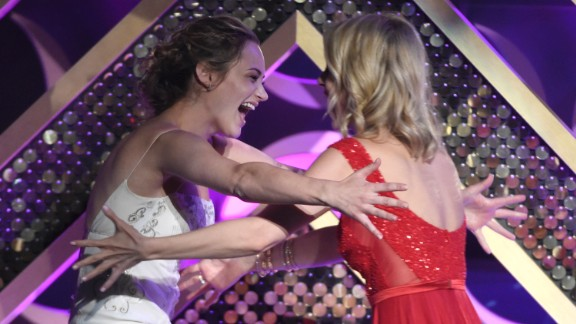 """Linsey Godfrey, right, presents Hunter King with the award for outstanding younger actress in a drama series. King won for her role on """"The Young and the Restless."""""""