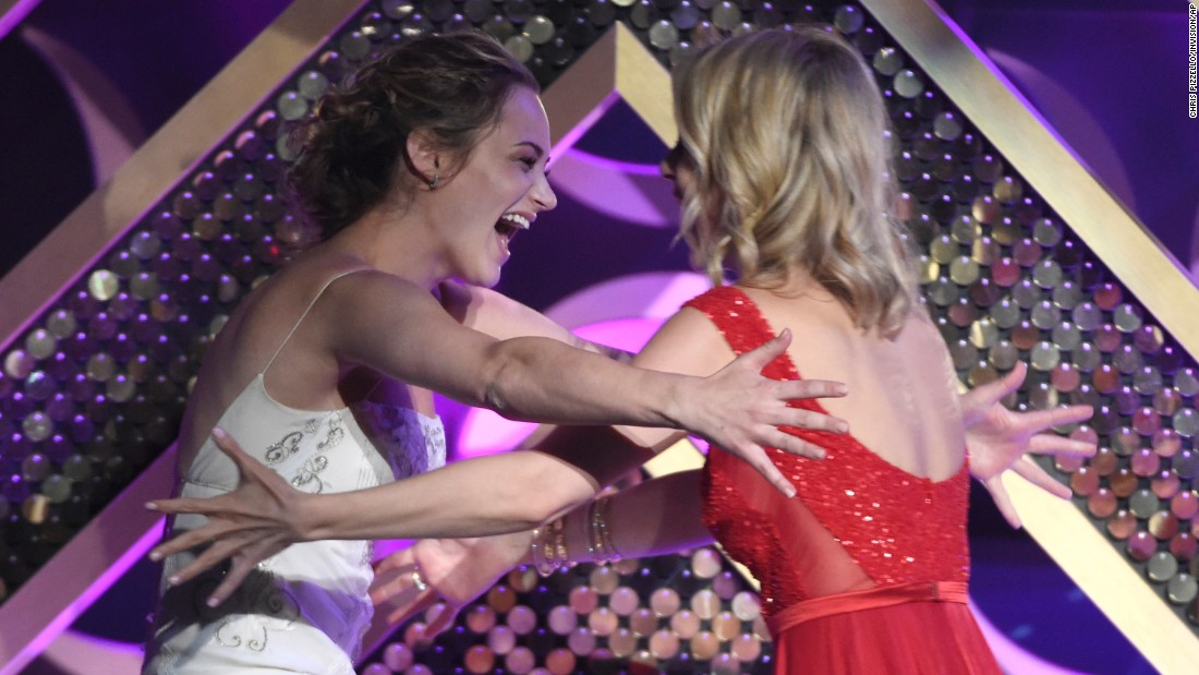 "Linsey Godfrey, right, presents Hunter King with the award for outstanding younger actress in a drama series. King won for her role on ""The Young and the Restless."""