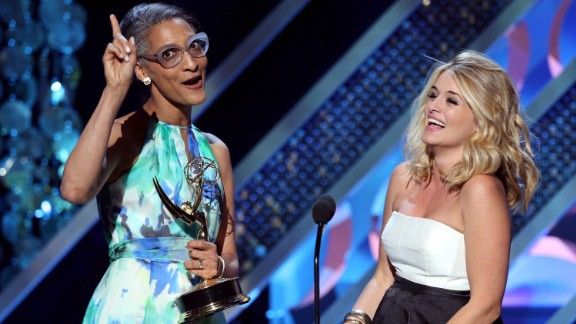 """Carla Hall, left, and Daphne Oz of """"The Chew"""" accept the award for outstanding informative talk show host."""