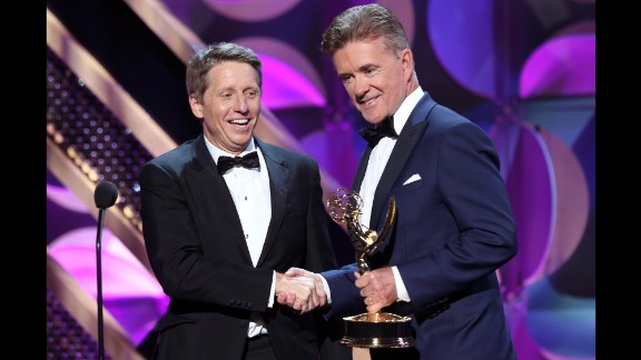 """Actor Alan Thicke, right, presents the award for outstanding drama series writing team to Bradley Bell, head writer and executive producer of """"The Bold and the Beautiful."""""""