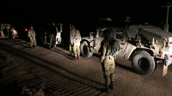 Israeli soldiers patrol the Golan Heights after airstrikes killed militants allegedly trying to plant a bomb.