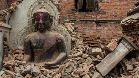 A Buddha statue is surrounded by debris on April 26 from a collapsed temple in the UNESCO world heritage site of Bhaktapur.
