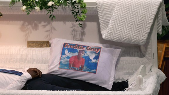 A pillow with Freddie Gray's image sits inside his casket during his funeral at the New Shiloh Baptist Church in Baltimore on Monday, April 27. Gray, 25, was arrested on April 12. According to his attorney, Gray died a week later from a severe spinal cord injury he received while in police custody.