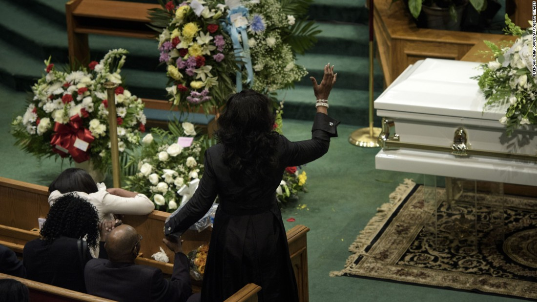 Gray's loved ones pray during his funeral.